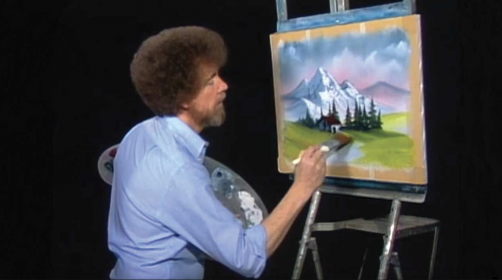 """Bob ross works away at a happy painting during an episode of """"The Joy of Painting With Bob Ross."""" (youtube.com)"""