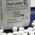 A bottle of OxyContin with pills scattered around