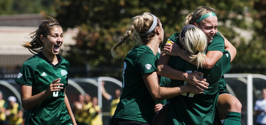 Bobcats teammates hug and celebrate after the first goal is scored during their game against Central Michigan on September 24, 2017 in Athens, Ohio. The Bobcats won the game 3-0. (Kelsey Brunner/WOUB)