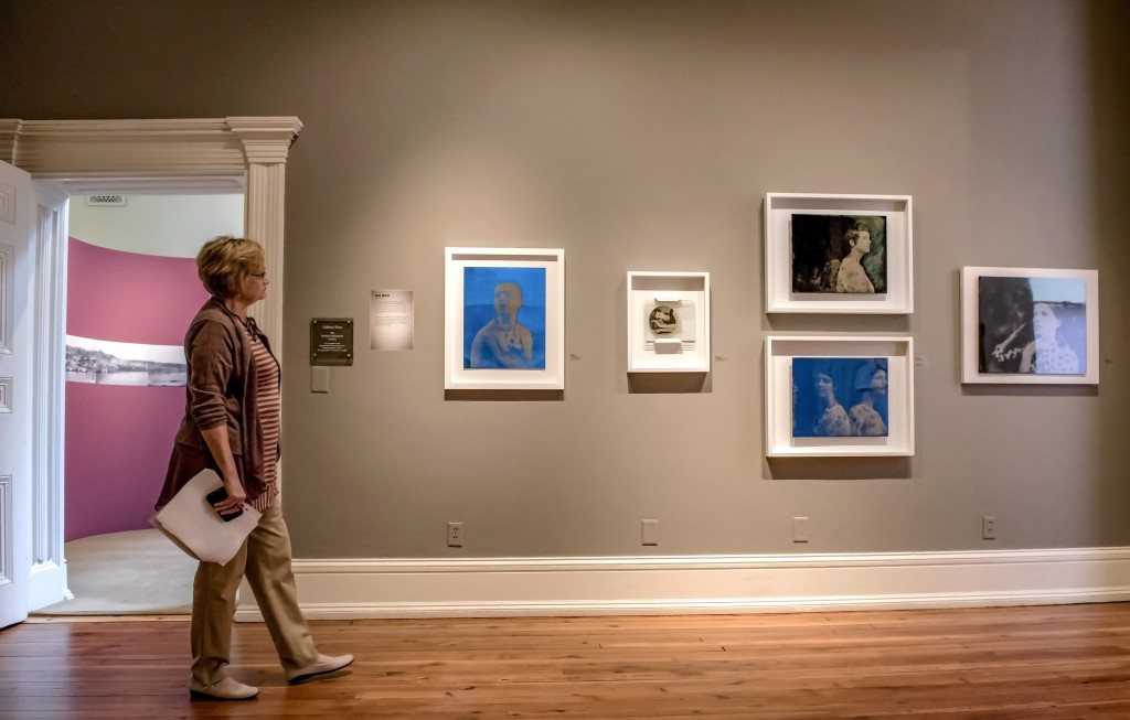 A viewer walks through the gallery at the Decorative Arts Center of Ohio. (WOUB/Margaret Sabec)