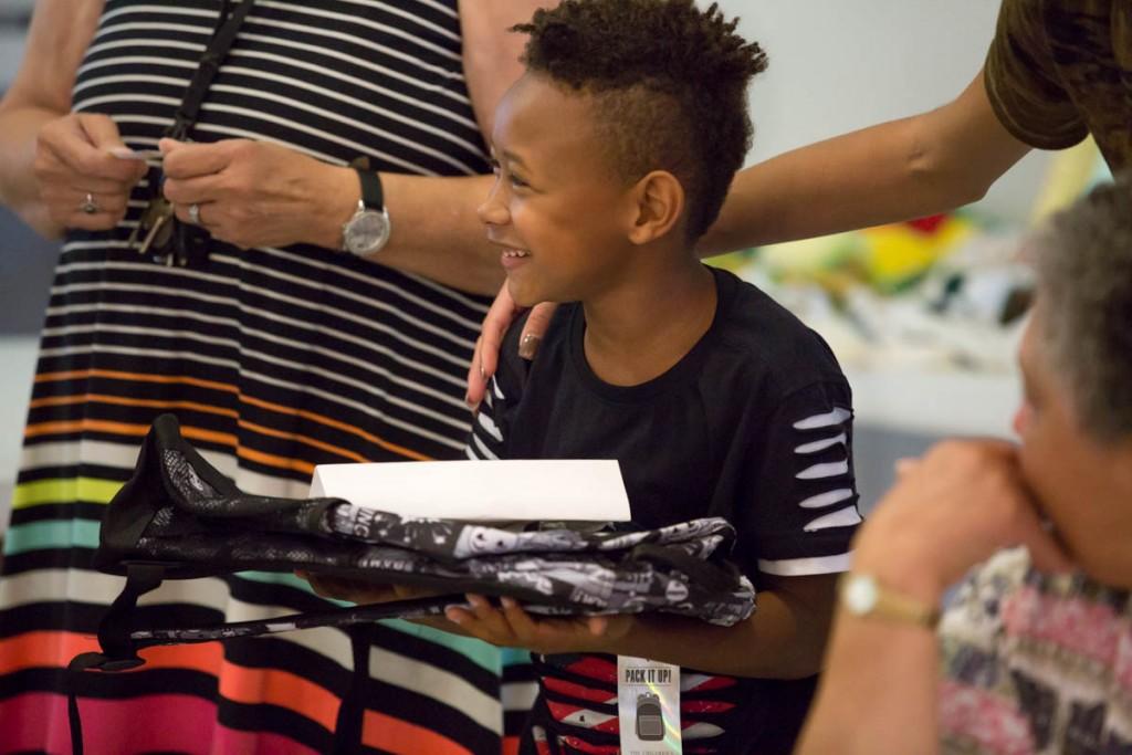 Kenyen Mayle, 7, of Kilvert, Ohio was one of the children's raffle winners at Kilvert Community Day in Kilvert, Ohio, on September 17, 2017.