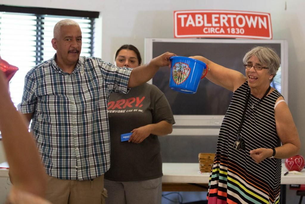 David Butcher and Linda Mayle draw the raffle winner at the Kilvert Community Center in Kilvert, Ohio, on September 17, 2017. (Haldan Kirsch/WOUB)