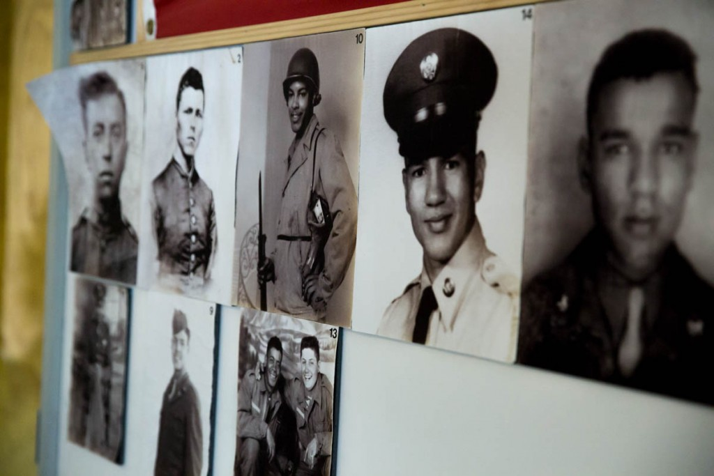 Photos of Kilvert citizens who served in the military decorate the wall of the Kilvert Community Center in Kilvert, Ohio, on September 17, 2017. According to David Butcher, a Kilvert citizen has served in every major U.S. war and still has several active military service members. (Haldan Kirsch/WOUB)