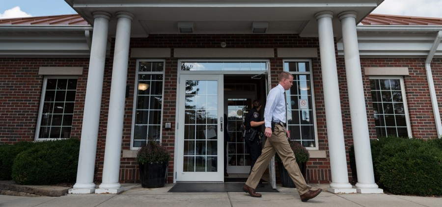 Athens Police Department Officer Brown holds door for APD Officer Simpson at Citizens bank on Stimson Ave. on Thursday, September 21 in Athens, Ohio. (Nickolas Oatley/WOUB)