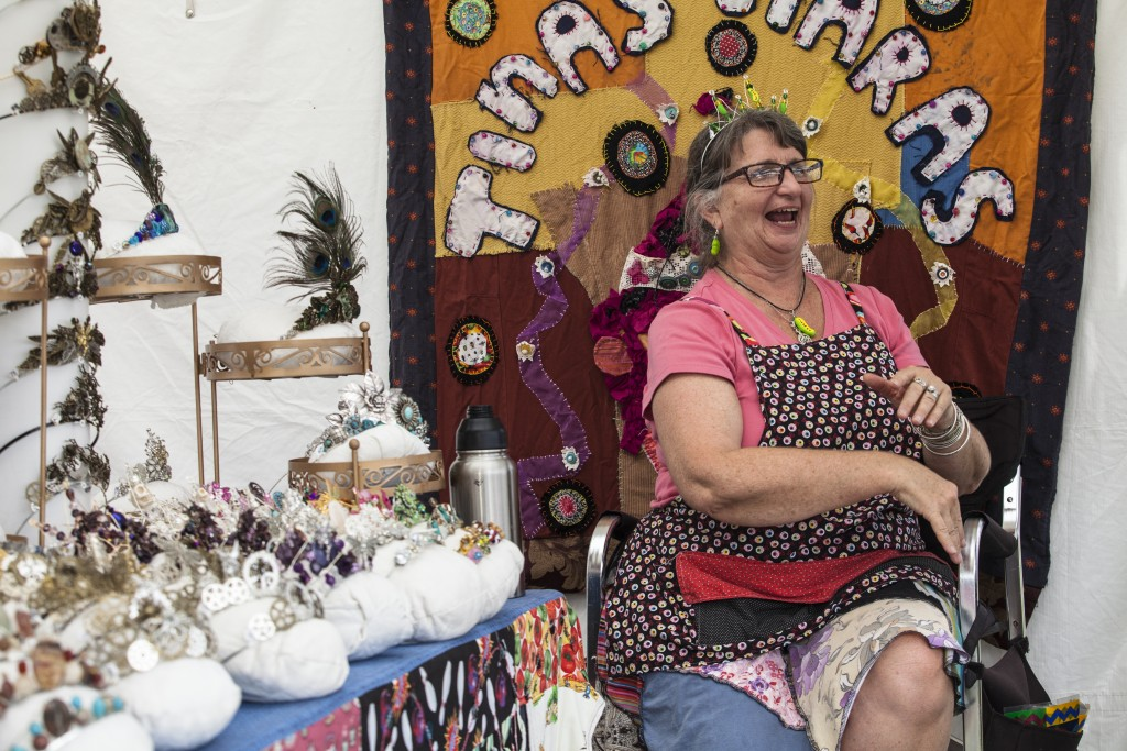 Tina Kelsay, a local artist , chats with her friend in front of  her handmade crown stall at the Paw Paw Festival in Albany, Ohio on Sep.16, 2017. (Wangyuxuan Xu/WOUB)