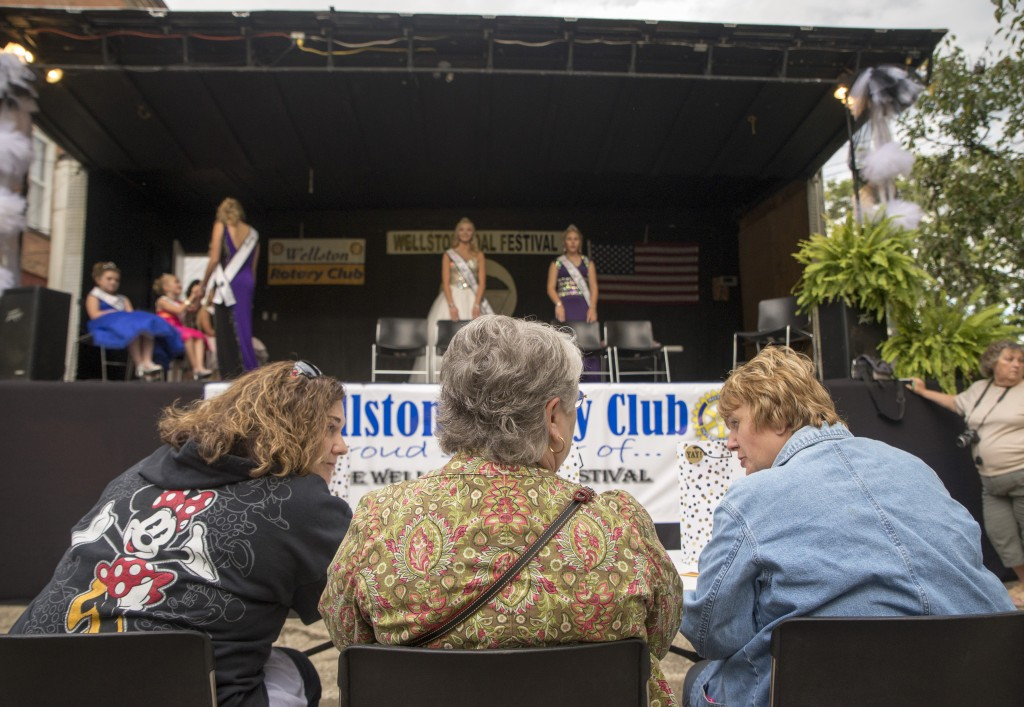 Judges for the Little Miss Coal Festival Queen Contest discuss about the pageant before the contestants take the stage (Austin Janning/WOUB)