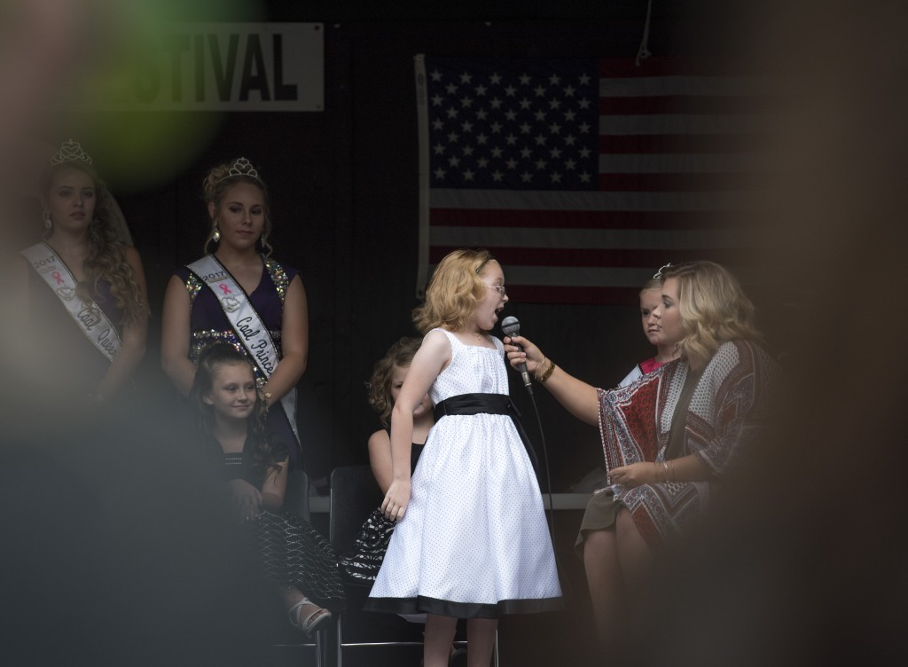 Marijane Barnett, a contest in the Little Miss Coal Festival Queen Contest, answers a question on stage. (Austin Janning/WOUB)