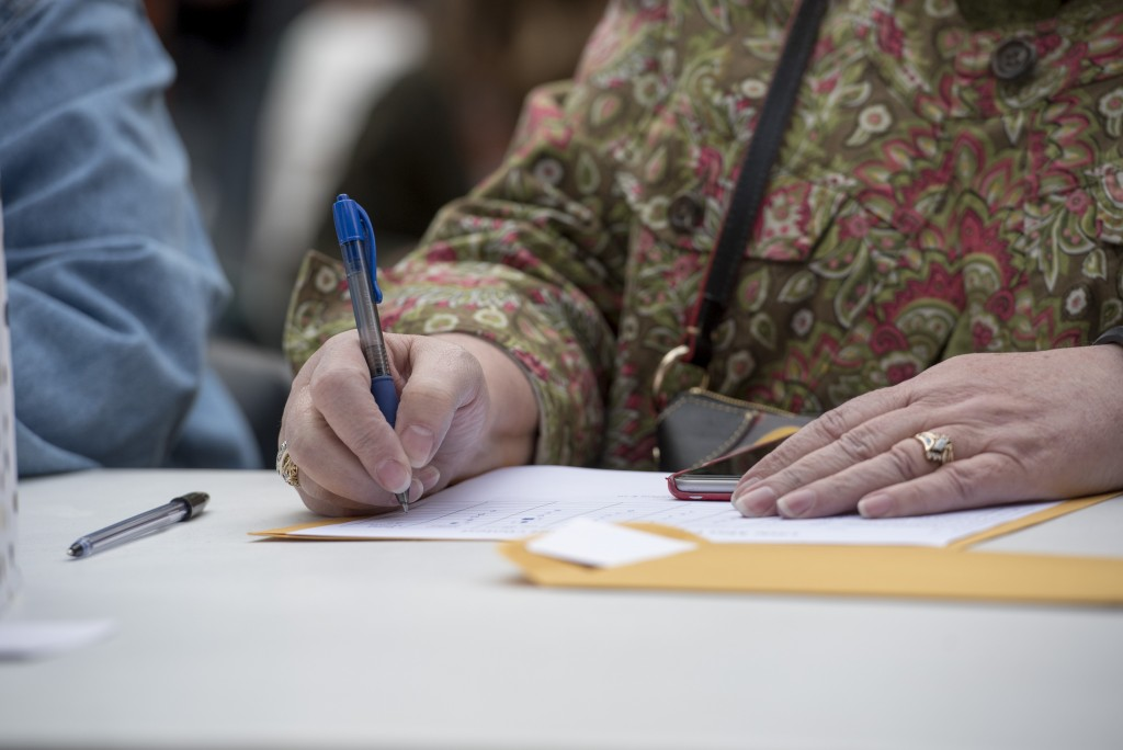 Dorcas Morrow, a judge at the Little Miss Coal Festival Queen Contest, writes down her review of a contestant after seeing them perform. (Austin Janning/WOUB)