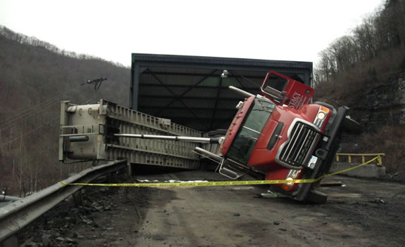 On February 3, 2017, a 54-year-old truck driver sustained hip and leg fractures when he jumped from the cab of his truck as it was overturning. He died 7 days later due to complications associated with his injuries. (MSHA)