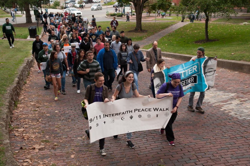 Participants in the Interfaith Peace Walk begin their route through the city, led by interns and volunteers from United Campus Ministries. (Drake S. Withers / WOUB)