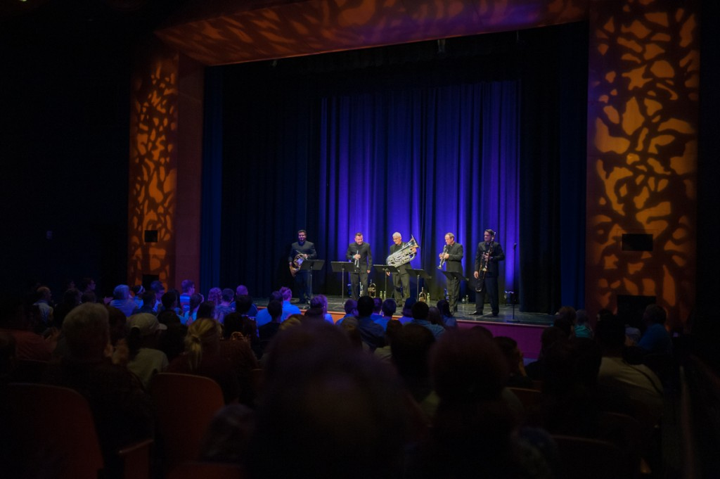 The Boston Brass, comprised of Chris Castellanos (left), Jose Sibaja, Sam Pilafian, Jeff Conner, and Domingo Pagliuca, introduce themselves at the beginning of their concert in the Baker Student Center Theater on Tuesday, Sept. 12, 2017. (Drake Withers / WOUB)