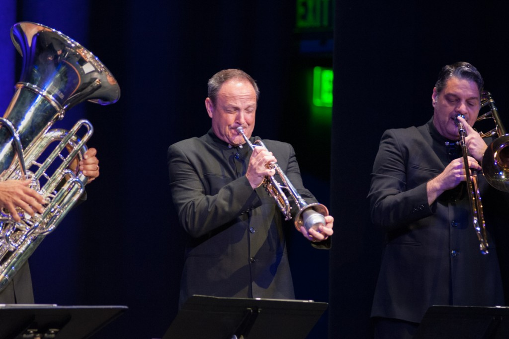 Jeff Conner plays into a muted trumpet with Sam Pilafian (left) on the tuba and Domingo Pagliuca (right) on trombone during the second song of the Boston Brass' performance on Tuesday, Sept. 12, 2017. (Drake Withers / WOUB)