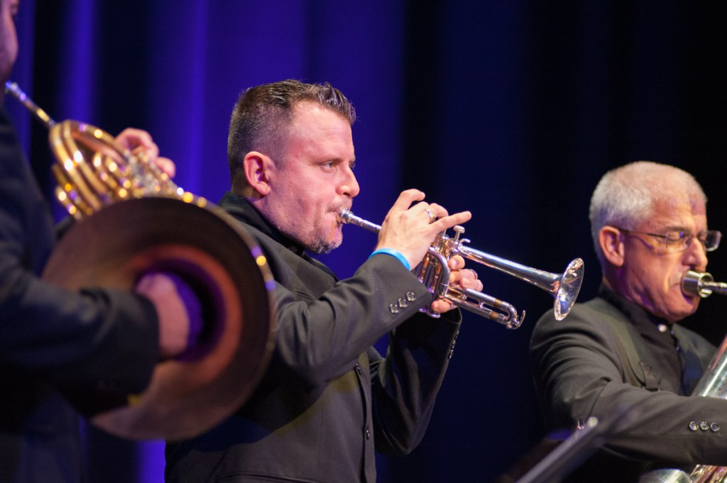 Jose Sibaja plays the trumpet with Chris Castellanos (left) on the horn and Sam Pilafian (right). (Drake Withers / WOUB)