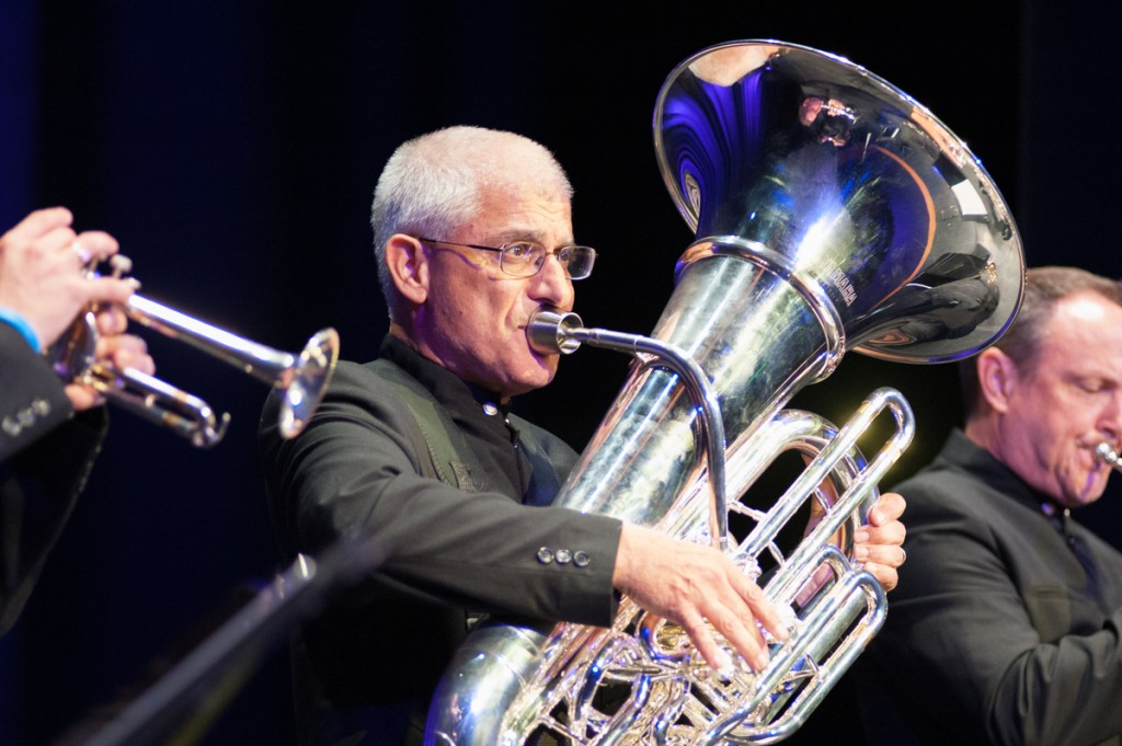 Sam Pilafian plays the tuba with Jose Sibaja on trumpet (left) and Jeff Conner on trumpet (right). (Drake Withers / WOUB)