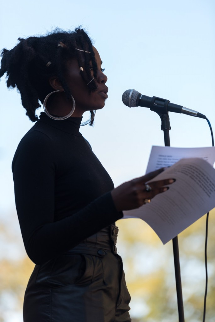 Jazzmine Zabriel, Philosphy and Communications Major, reads poetry at Scripps Ampitheatre with friend Prince Shakur. (Nickolas Oatley/WOUB)