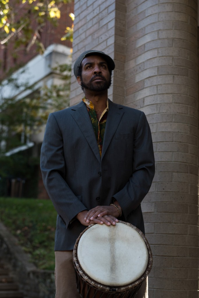 A djembe performer awaits to play in front of people gathered at Scripps Ampitheatre. (Nickolas Oatley/WOUB)