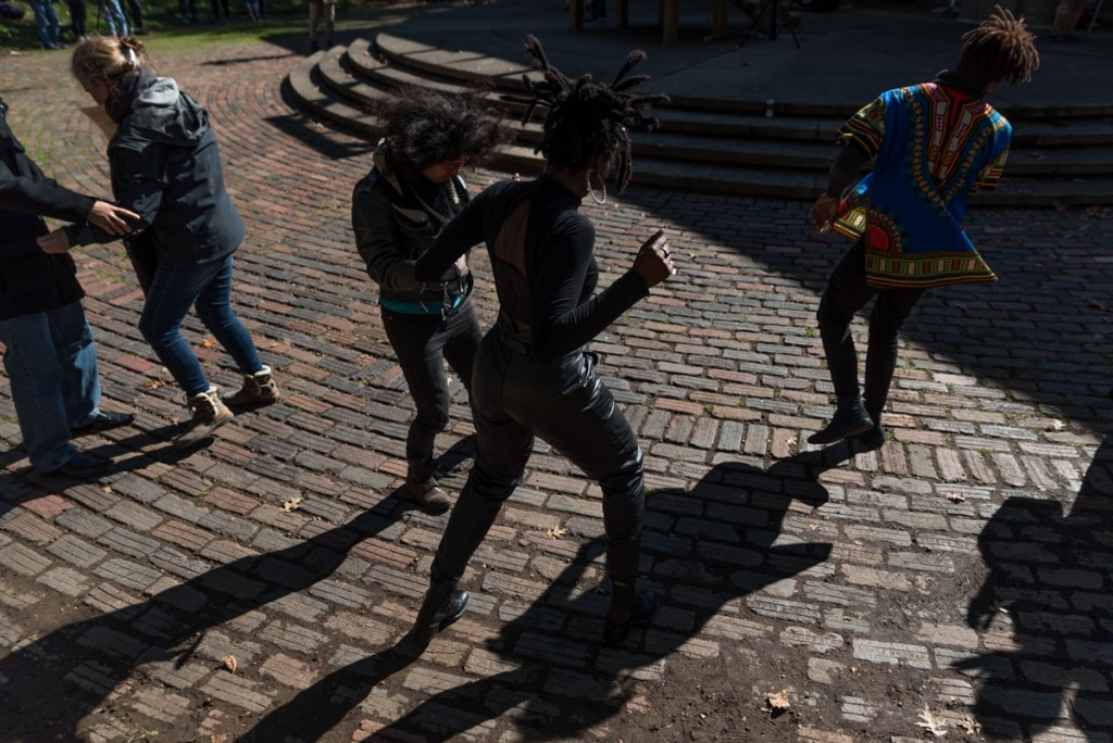 Jazzmine Zabriel, Prince Shakur and others present at the public hanging dance around the ampitheatre. (Nickolas Oatley/WOUB)