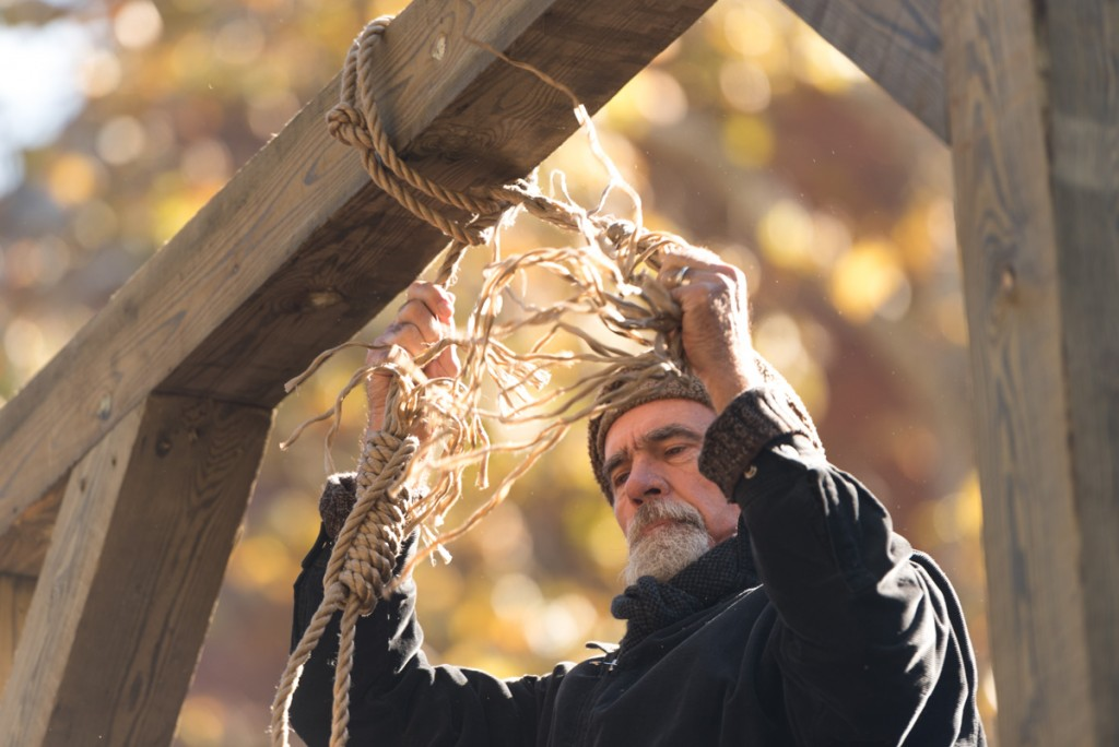 The Confederate Flag is hung from a noose at the top of a 13-foot gallows. (WOUB/ Nickolas Oatley)