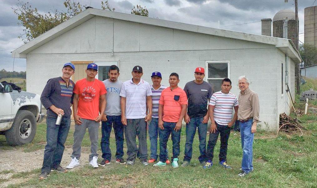 Stephen Bartlett of FLOC (left) with striking farm workers Lamberto Gonzales, Fernando Guzman, Francisco Gonzales, Hernan Quezada, Jose Gonzales, Cristian Santillan, Adolfo Osorio; and Felix Garza of the National Farm Worker Ministry. (Benny Becker | Ohio Valley ReSource)