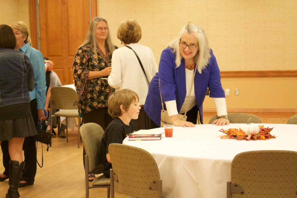 Those gathered for the meet and greet before Leon Logothetis' speaking engagement enjoyed light refreshments and friendly company. (WOUB/Emily Votaw)