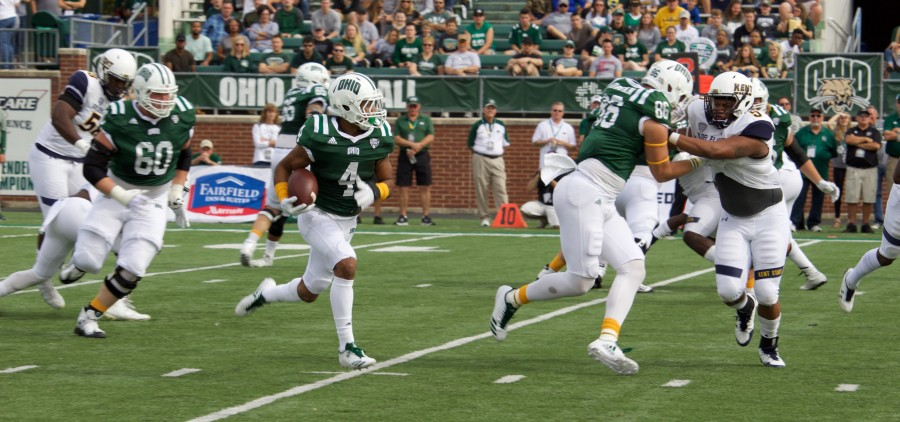 Papi White runs with the ball against Kent State.    Photo Credit: Joe Medlen