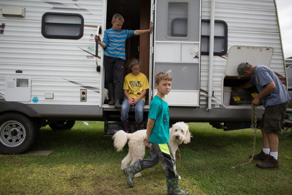 The Lucas Family packs up their trailer after a week long family reunion at the Bob Evans Farm Festival on October 15, 2017.                       (Michael Johnson/WOUB)