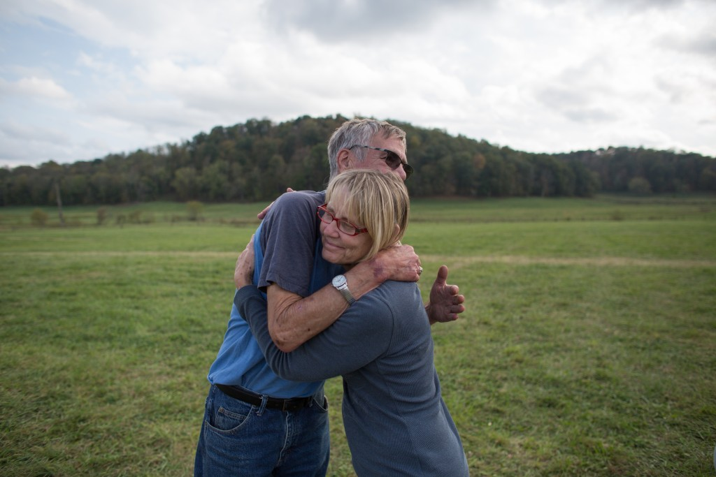 Gary Campbell and his sister-in-law, Terri embrace before leaving their 47th annual family reunion at the Bob Evans Farm Festival in Rio Grande, Ohio, on October 15, 2017.   (Michael Johnson /WOUB)