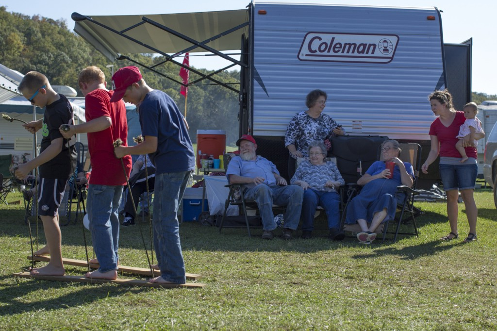 Members of the Campbell family watch the youngest members during a race at the annual family gathering during the Bob Evans Farm Festival in Rio Grande, Ohio, on October 14, 2017. (Haldan Kirsch?WOUB)