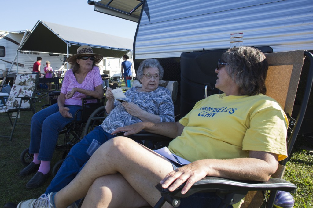 Kathie Campbell, left to right, Pearl Campbell and Priscilla Campbell look at photos from past years of the Bob Evans Farm Festival in Rio Grande, Ohio, on October 14, 2017. The family's annual gathering is in danger due to a change in ownership at Bob Evans causing rumors of the festival's cancellation. (Haldan Kirsch/WOUB)