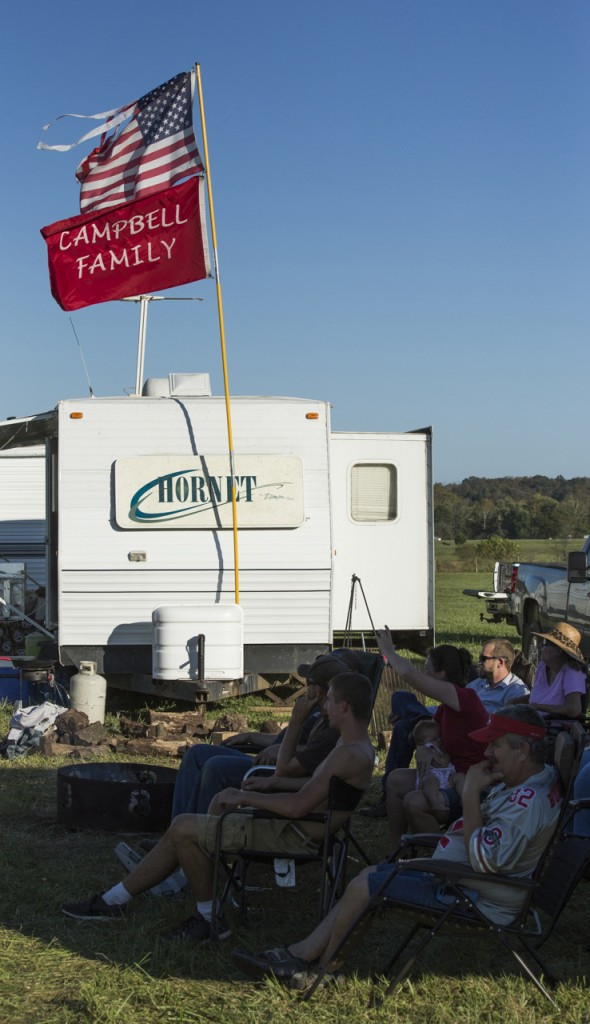 Members of the Campbell family sit in the shade to watch their annual Corn Hole tournament at the Bob Evans Farm Festival in Rio Grande, Ohio, on October 14, 2017. (Haldan Kirsch/WOUB)