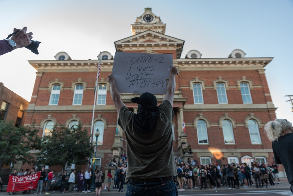 A Trump supporter protests across the street from the Y(OU) Can't Silence Dissent Protest in front of the Athens Court House on Friday, October, 21. (Nickolas Oatley)