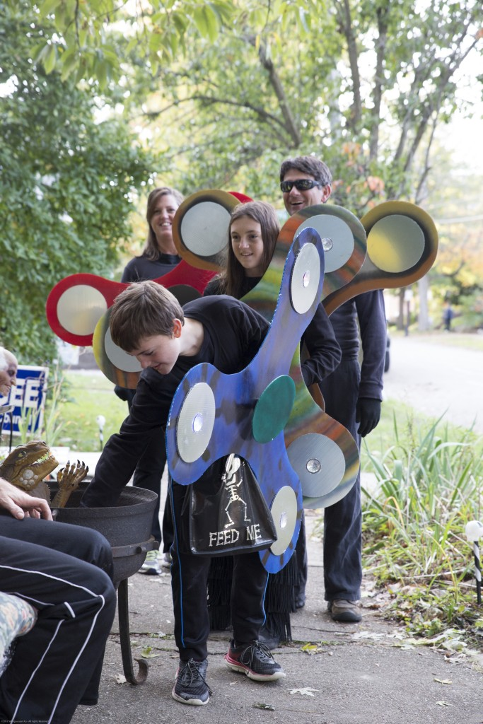 Christopher Harris, 10, and Sarah Harris,11, dress up as fidget spinners with their parents, Bill and Linda, for trick-or-treating in Athens, Ohio on Oct. 26, 2017. (Wangyuxuan Xu/ WOUB)