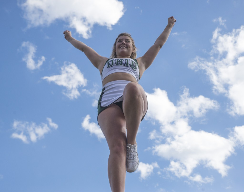 An Ohio University cheerleader cheers on the sidelines during Ohio University's homecoming football game against Central Michigan on Saturday. (Austin Janning/WOUB)