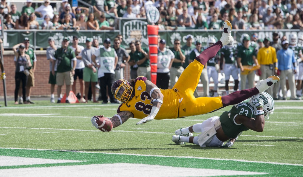 Central Michigan tight end Tyler Conklin (83) leaps over Ohio safety Kylan Nelson (23) to score a touchdown during Ohio University's homecoming football game against Central Michigan on Saturday. (Austin Janning/WOUB)