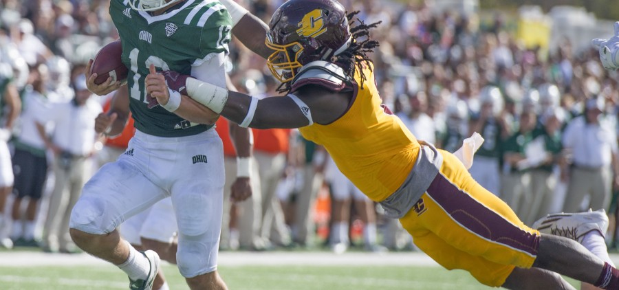 Ohio quarterback Nathan Rourke (12) breaks a tackle during Ohio University's homecoming football game against Central Michigan on Saturday. (Austin Janning/WOUB)