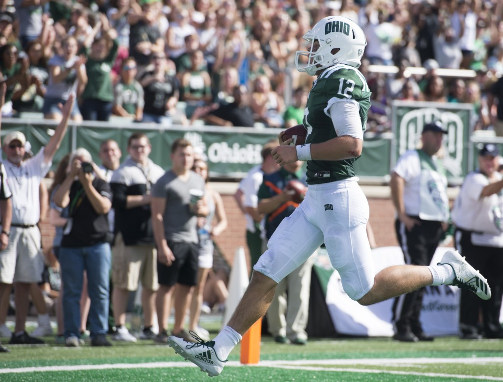 Ohio quarterback Nathan Rourke (12) runs into the end zone to score a touchdown for Ohio during Ohio University's homecoming football game against Central Michigan on Saturday. (Austin Janning/WOUB)