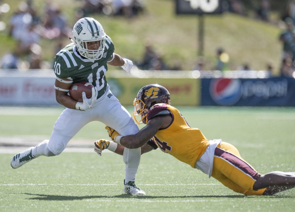 Ohio quarterback Joey Duckworth (10) breaks a tackle from Central Michigan defensive back Josh Cox (14) during Ohio University's homecoming football game against Central Michigan on Saturday. (Austin Janning/WOUB)