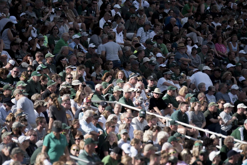 Fans attending the Ohio University homecoming game look onward onto the field to watch the game happening. (Austin Janning/WOUB)