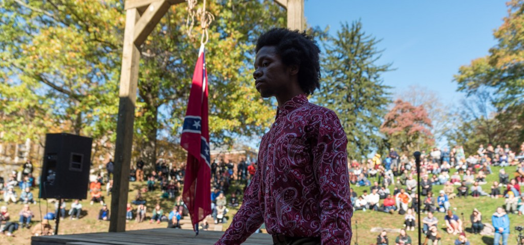 ShaVaughn Peterson walks off stage after singing the National Anthem. (Nickolas Oatley/WOUB)