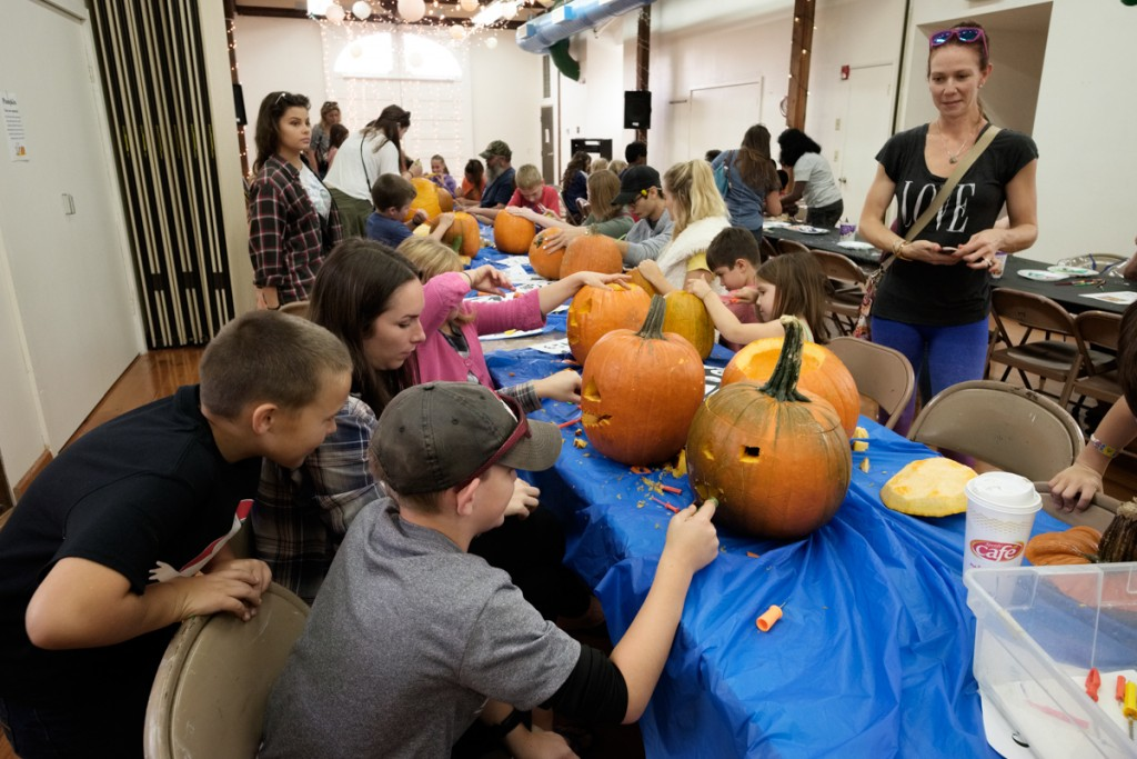 Community members carve pumpkins in The Dairy Barn Arts Center in Athens, Ohio, on Saturday, Oct. 21, 2017. (Drake Withers / WOUB)