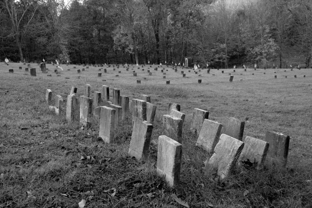 A group of found tombstones represent deceased people whose bodies have not yet been discovered at the Old Athens Hospital Cemetery in The Ridges. (Drake Withers / WOUB)