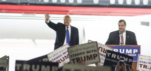 """Governor of New Jersey Chris Christie makes a surprise appearance and introduces Donald Trump to a large crowd in Columbus, Ohio for a Donald Trump rally on March 1, 2016. """"America needs strength in the oval office again...,"""" said Governor Christie."""