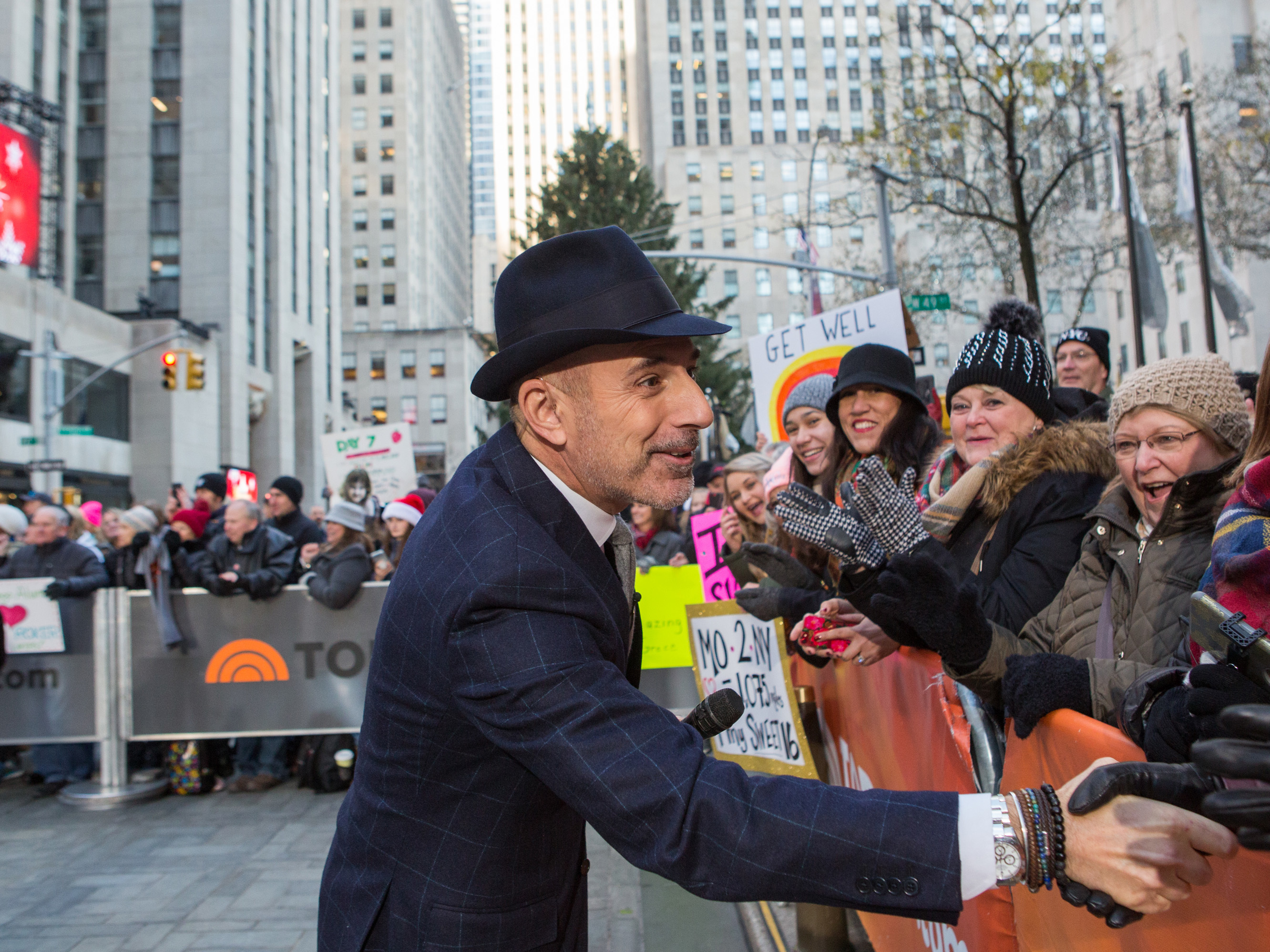 """Longtime """"Today"""" host Matt Lauer greets people in the crowd on Monday. He is the latest high-profile media figure to be accused of sexual misconduct."""