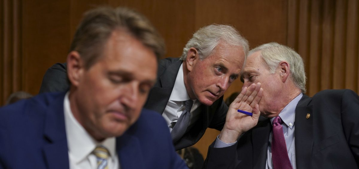 Sens. Jeff Flake, R-Ariz., Bob Corker, R-Tenn., and Ron Johnson, R-Wis., seen at a hearing earlier this month, held up floor action on Thursday evening over concerns about how to control the deficit if the GOP tax bill doesn't result in strong economic growth.