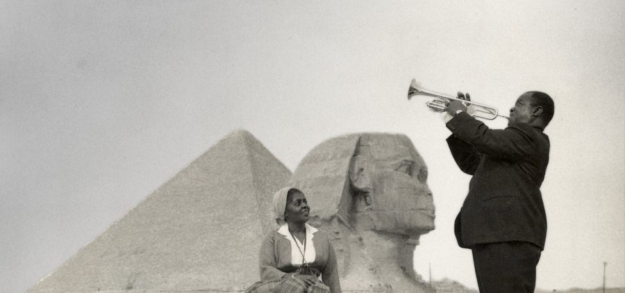 Louis Armstrong and his wife Lucille pose in front of the Sphinx near Cairo, Egypt in 1961.