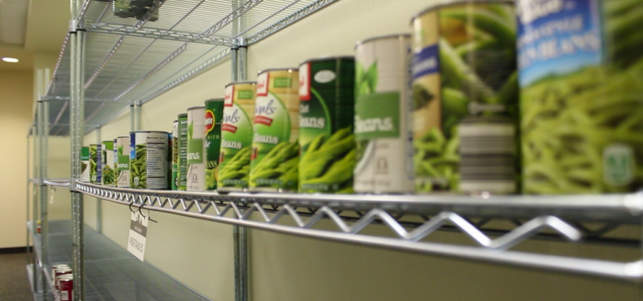 Cans sit unused on the shelves of the Baker University Center Food Pantry