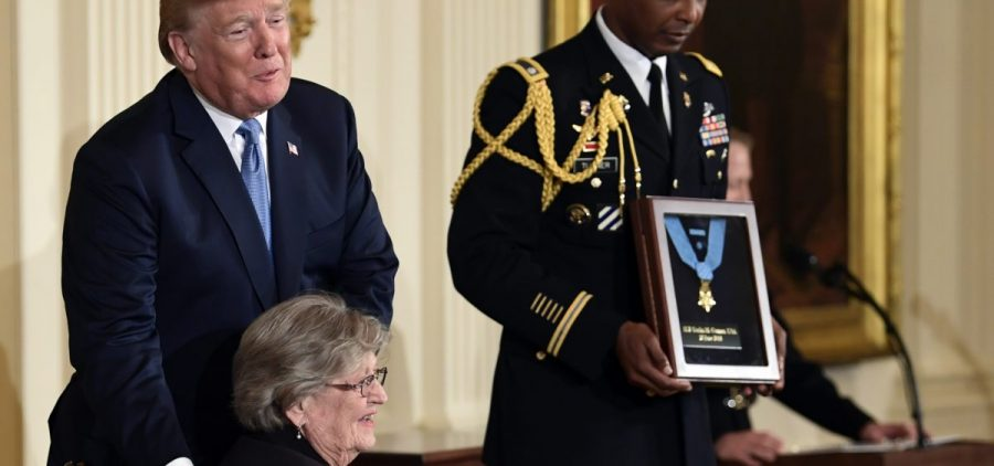 President Donald Trump with Pauline Conner, widow of 1st Lt. Garlin Conner, during a ceremony at the White House Tuesday. Trump presented the Medal of Honor posthumously to Conner for his actions in January 1945 during World War II.