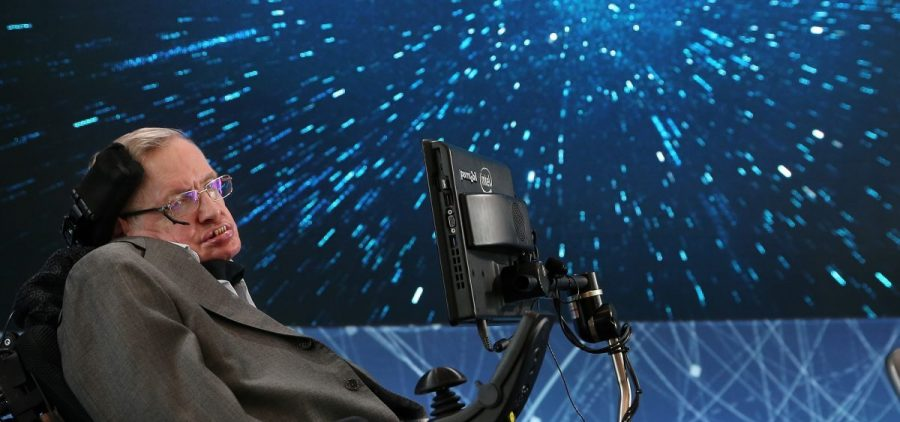 "Professor Stephen Hawking sits onstage during the ""Breakthrough Starshot"" announcement at One World Observatory on April 12, 2016 in New York City."