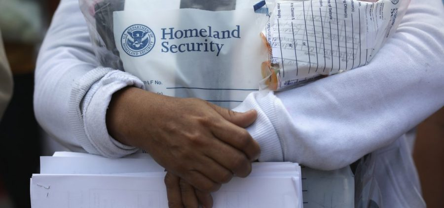 Central American immigrants depart ICE custody, pending future immigration court hearings, on June 11 in McAllen, Texas.