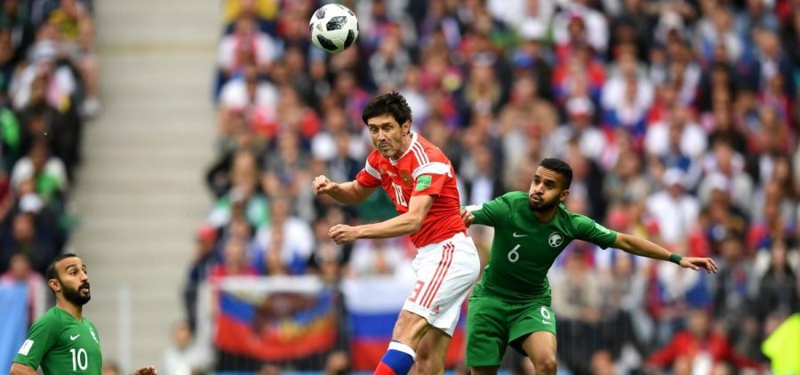Yury Zhirkov of Russia wins a header Mohammed Alburayk of Saudi Arabia during the 2018 FIFA World Cup Russia Group A match between Russia and Saudi Arabia at Luzhniki Stadium on Thursday in Moscow, Russia.